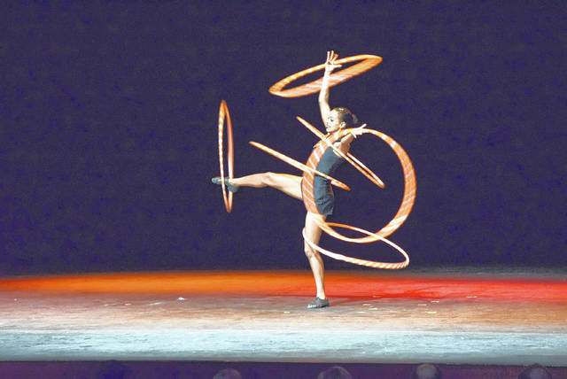 This unnamed Cirque Zuma Zuma performer demonstrates exceptional hula hoop skills.
