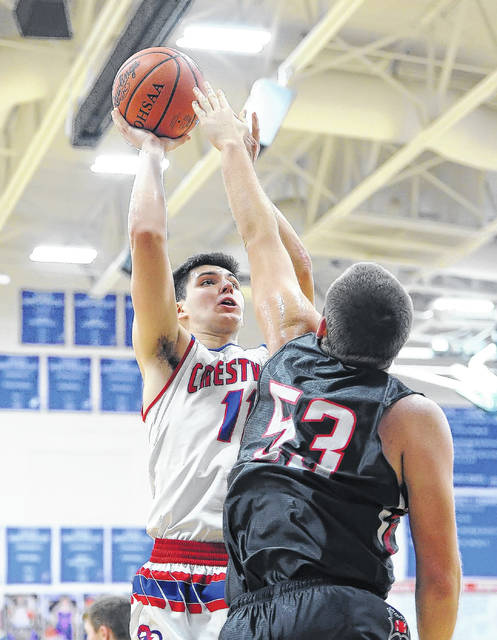Crestview's Derek Stout puts up a shot against Spencerville's Ben Dues during Friday night's game at Ray Etzler Gymnasium in Convoy.