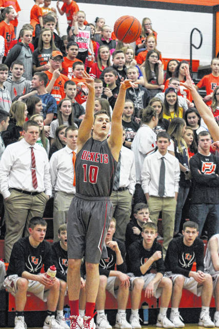 Pandora's Drew Johnson lets a three-pointer fly infront of the student section of Fort Jennings on Saturday night.