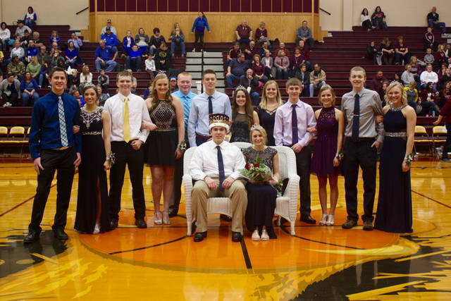 Included on the Kalida High School homecourt court are, from left, senior attendants Kevin Hamburg and Kierstan Siebeneck, freshmen attendants Adam Basinger and Dayna Schimmoeller, junior attendants Josh Verhoff and Irene Jimenez Gonzalez, sophomore attendants Josh Recker and Kyla Fortman and senior attendants Jacob Kahle and Kara Siefker. Noah Hermiller and Taylor Lucke (center) were named King and Queen of the court, respectively.