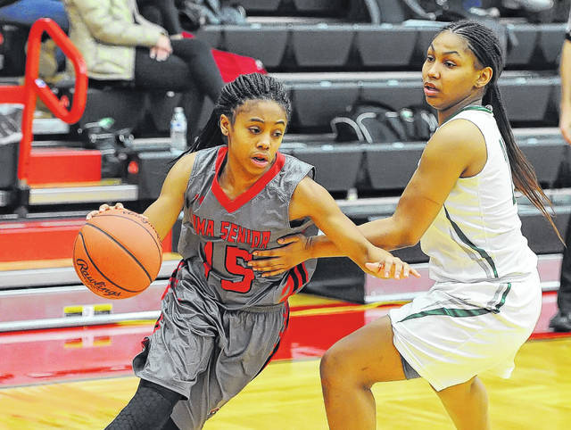 Lima Senior's Destiny McDonald drives against Toledo Start's Alasia Easley during a Thursday night Division I sectional final at Fostoria High School. See more game photos at LimaScores.com.