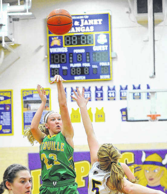 Ottoville's Kasey Knippen shoots against Leipsic's Peyton Henry during a Putnam County League matchup at Leipsic.