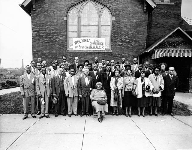 This photo from 1950 shows an NAACP gathering at Fourth Street Missionary Baptist Church. Jacob Jones (of Jones Brothers mortuary) is on left of front row. The Rev. Leroy McGee is at center front of picture in a dark suit, and his wife Luella is seated next to him. All others are from out of town. The meeting's speaker, Clarence G. Smith, Toledo attorney and president of the Ohio Conference of Branches of the NAACP is immediately behind Mr. & Mrs. McGee.