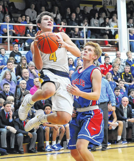 Ottawa-Glandorf's Owen Hiegel goes up for a shot against Liberty-Benton's Seth Lasiter during a game at O-G's Robert J. Hermiller Gymnasium.