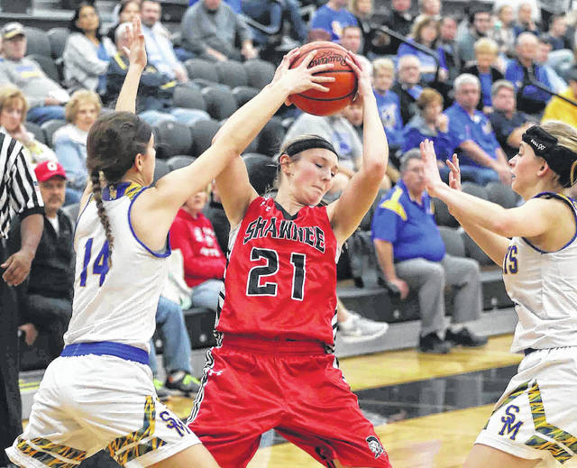 St. Marys' Jill Schmitmeyer, left, and Lauren Cisco pressure Shawnee's Alissa Stahler during a Division II tournament game in Spencerville. See more tourney photos at LimaScores.com.