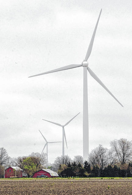 The placement of wind turbines, such as the ones in this 2016 Lima News file photo, slowed in Ohio last year. One major wind project last year was the Hog Creek Wind Farm in Hardin County, a 66-megawatt facility that went online in December.