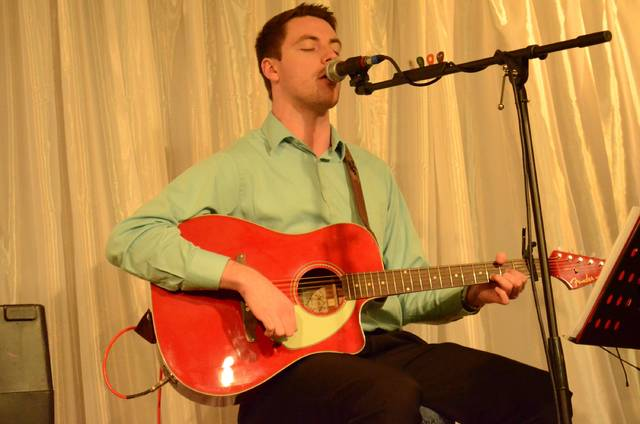 """Jeff Burgei, son of Ottawa Area Chamber of Commerce Director Cathy Burgei, sings a cover of Green Day's """"Boulevard of Broken Dreams"""" while providing background music during the 97th annual Ottawa Area Chamber of Commerce Member Appreciation Dinner Thursday at The American Legion Post 63."""