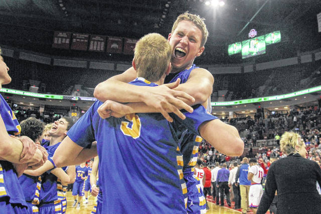 Marion Local's Sam Huelsman, right, embraces teammate Nathan Bruns after the Flyers defeated Cornerstone Christian in Saturday's Division IV state championship game in Value City Arean at the Schottenstein Center in Columbus. See more game photos at LimaScores.com.  Levi A. Morman | The Lima News