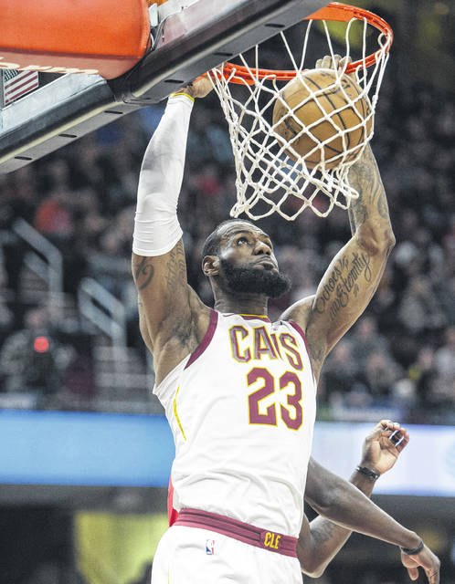 The Cavaliers' LeBron James dunks during Friday night's game against New Orleans in Cleveland.