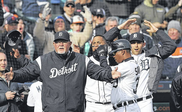 Manager Ron Gardenhire and members of the Tigers react after a safe call at the plate that would have given the Tigers a victory against Pittsburgh in the 10th inning of Friday's game in Detroit was overturned.
