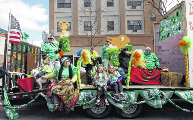 Members of the Brennan clan sit on their Dr. Seuss-themed float during the 2017 St. Patrick's Day Parade in downtown Lima. This year's parade is scheduled to start at noon Saturday along North Main Street in Lima.