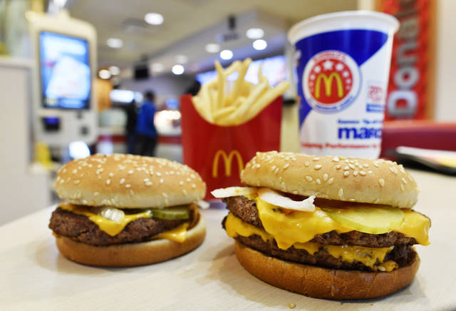 A McDonald's Quarter Pounder, left, and Double Quarter Pound burger are shown with fresh beef Tuesday, March 6, 2018, in Atlanta. McDonald's is offering fresh beef rather than frozen patties in some burgers at thousands of restaurants, a switch it first announced about a year ago as it works to appeal to customers who want fresher foods. (AP Photo/Mike Stewart)