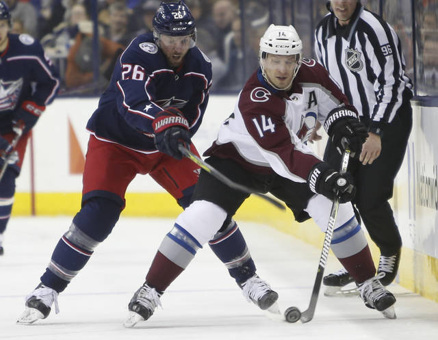 Colorado Avalanche's Blake Comeau, right, carries the puck across the blur line as Columbus Blue Jackets' Thomas Vanek, of Austria, defends during the first period of an NHL hockey game Thursday, March 8, 2018, in Columbus, Ohio. (AP Photo/Jay LaPrete)