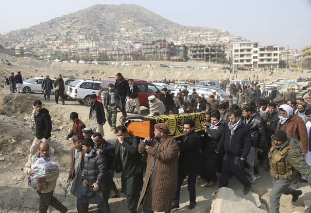 "FILE - In this Jan. 28 file photo, men carry the coffin of a relative who died in the Jan. 27 deadly suicide attack in Kabul, Afghanistan. The deadly explosion caused by a suicide bomber driving an ambulance in the capital. Is Afghanistan really America's forgotten war? Consider this: At a Senate hearing this week on top U.S. security threats, the word ""Afghanistan"" was spoken exactly four times, each during introductory remarks. In the ensuing two hours of questions for intelligence agency witnesses, no senator asked about Afghanistan, suggesting little interest in a 17-year war with nearly 15,000 U.S. troops supporting combat against the Taliban."