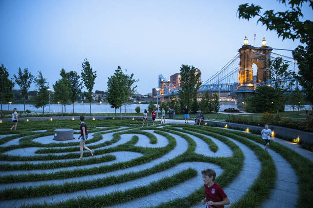 FILE - In this June 22, 2015, file photo, pedestrians navigate a labyrinth at Smale Riverfront Park in Cincinnati. Cincinnati's wooing Amazon's second headquarters offered urban cool and culture along with big-bucks incentives. (AP Photo/John Minchillo, File)