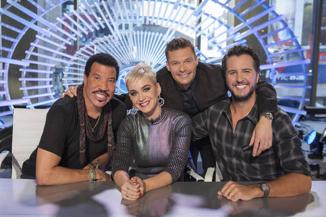 "This image released by ABC shows, from left, Lionel Richie, Katy Perry, Ryan Seacrest and Luke Bryan on the set of ""American Idol"" in New York. The season premiere had a strong debut on ABC, reaching more than 10 million viewers."