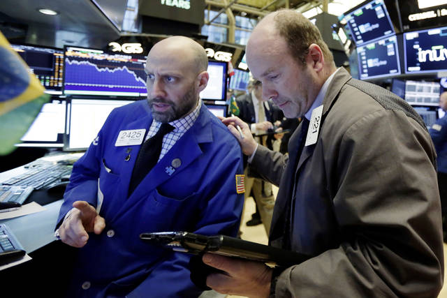 Specialist Meric Greenbaum, left, and trader Peter Mancuso work on the floor of the New York Stock Exchange, Monday, March 26, 2018. U.S. stocks rose sharply in early trading Monday as the market made up some of its huge losses from last week. (AP Photo/Richard Drew)