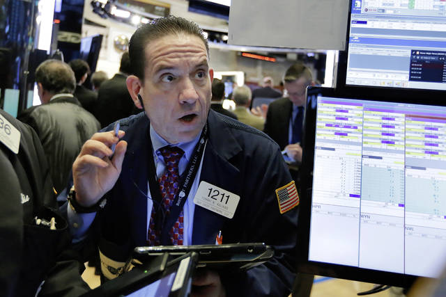 Trader Tommy Kalikas works on the floor of the New York Stock Exchange, Monday, March 26, 2018. U.S. stocks rose sharply in early trading Monday as the market made up some of its huge losses from last week. (AP Photo/Richard Drew)