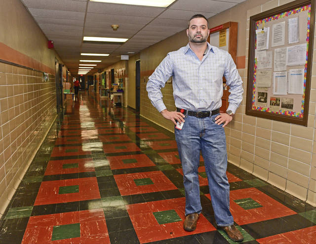 This Thursday, Jan. 19, 2017 photo shows Ryan Sheridan posing for a portrait in the hallway of the Rich Center for Autism in Youngstown, Ohio. A forfeiture complaint filed last week by the U.S. Attorney's Office in Cleveland seeks to keep around $3.5 million in assets seized from 38-year-old Sheridan after raids at his treatment centers in suburban Youngstown and suburban Columbus.(David Dermer/The Youngstown Vindicator via AP)