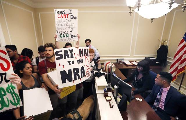 FILE- This Feb. 21, 2018 file photo shows students at the entrance to the office of Florida Gov. Rick Scott with boxes of petitions for gun control reform, at the state Capitol in Tallahassee, Fla.  Student survivors of the mass shooting in Florida who've organized to increase gun control and make schools safer aren't being bankrolled by billionaire liberal philanthropist George Soros, despite the claims of several false stories. Soros is not providing any funding to the students at Marjory Stoneman Douglas High School in Parkland although he does support their efforts, said his spokeswoman, Laura Silber.AP Photo/Gerald Herbert, File)