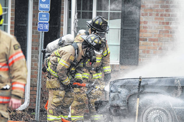 Fire Fighters from American Township were fighting a vehicle engulfed by flames outside of The Center For Autism & Dyslexia Lima Center at 2280 Baton Rouge road early Tuesday morning in Lima.