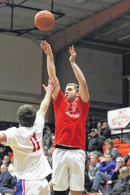 Ottawa-Glandorf's Jay Kaufman puts up a shot against Liberty-Benton's Austin May during Tuesday night's District Division I-II-III All-Star Game at the Elida Fieldhouse. See more game photos at LimaScores.com. Levi A. Morman | The Lima News