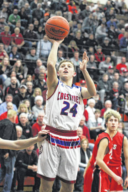 Crestview's Derick Dealey puts up a shot attempt during Friday night's Division IV district championship game at the Elida Field House.