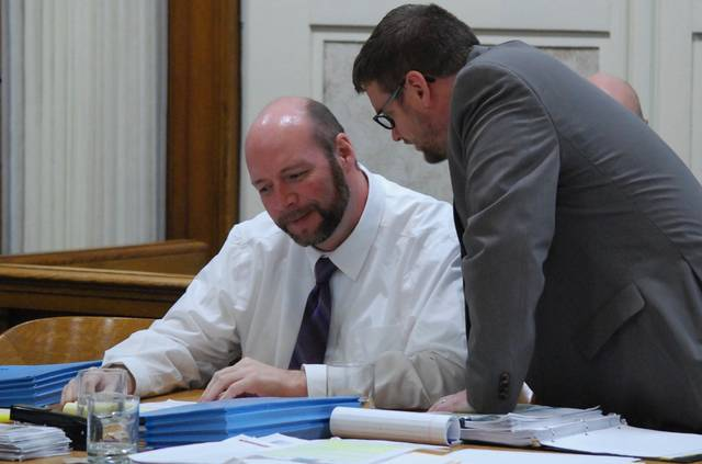 "Gerrick ""Tony"" Sheldon confers with his attorney, Jeff Ratliff, Friday in Hardin County Common Pleas Court during his trial on charges of complicity to attempted aggravated murder. Sheldon is alleged to have orchestrated a scheme to have his ex-wife's house burned to the ground in August of last year."