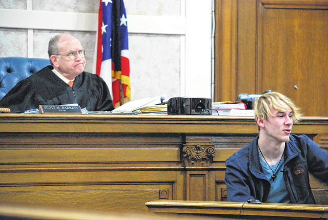 J Swygart | The Lima News Garrett Sheldon was submitted to nearly 3 1/2 hours of cross-examination Tuesday in the trial of his father, Gerrick Sheldon. Hardin County Common Pleas Court Judge Scott Barrett looks on as the 16-year-old responds to a question from defense attorneys.