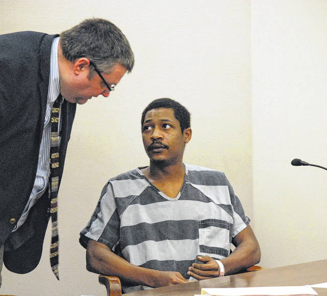 J Swygart | The Lima News  Decorion Dawson, 26, of Lima, was sentenced to four years in prison Monday on a charge of aggravated robbery, a second-degree felony. The sentence was consistent with a negotiated agreement between Dawson and the Allen County Prosecuting Attorney's office. Dawson is pictured with his attorney, John Hopkins.