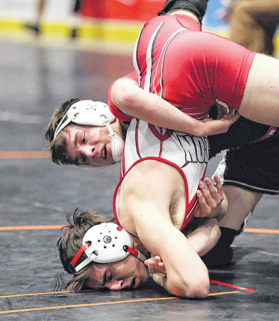 Lima Central Catholic's Joey Carella, here competing against Milton-Union's Dylan Schenck during Saturday's Division III district in Troy, is 40-0 entering this week's state championships. Don Speck | The Lima News