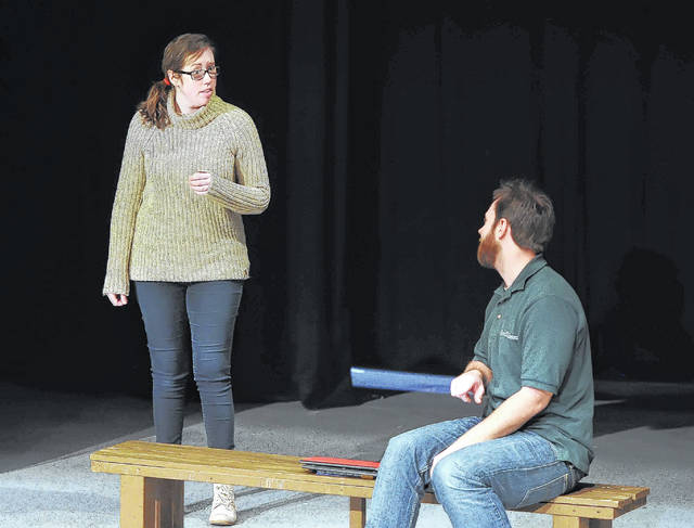 "Josh Ellerbrock, right, and Lauren Spyker rehearse scenes from ""Almost, Maine"" at Encore Theatre. The production begins today and runs through March 18."