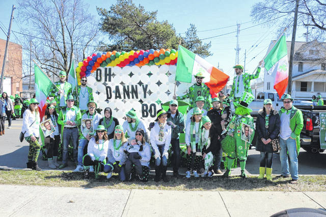 Friends and family of Danny Killian pose for a photo prior to the 2018 Lima Irish Parade.