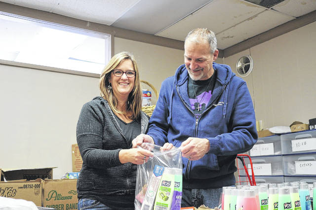 Heather and Dave Roznowski pack blessing bags, some will go to homeless veterans.