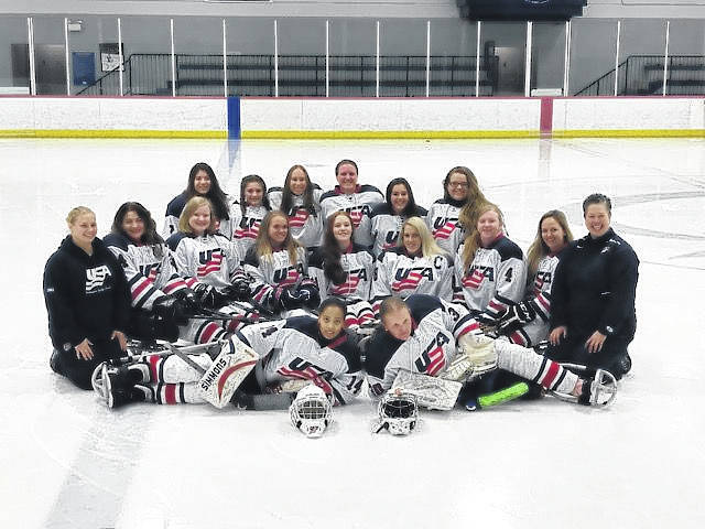 U.S. Women's National Sledge Hockey Team. Kelli Anne is in the second row, third from the left.