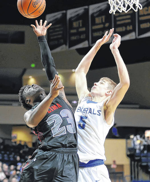 Lima Senior's Jourdyn Rawlins shoots against Anthony Wayne's Max Denman during the Division I district semifinal game at the University of Toledo Wednesday.