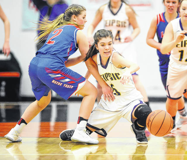 Leipsic's Peyton Henry, right, goes to the floor for a loose ball against Wayne Trace's Claire Sinn during a Thursday night Division IV regional semifinal at the Elida Fieldhouse.
