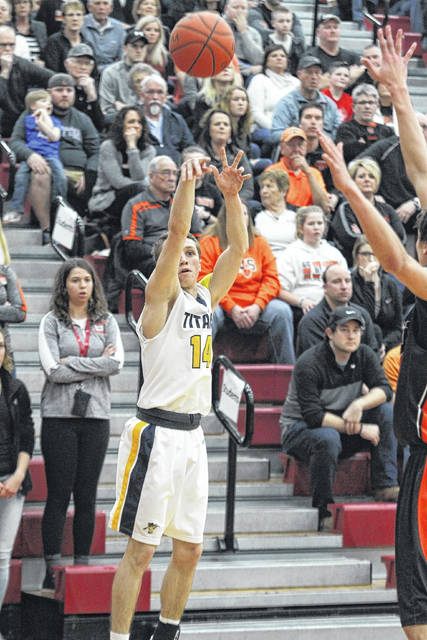 Ottawa-Glandorf's Bryce Schroeder puts up a shot against Coldwater during Saturday night's Division III district final at Lima Senior.