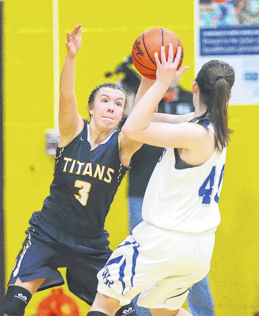 Ottawa-Glandorf's Ashley Schroeder, playing defense against Western Reserve, will be tested along with her teammates, when the Titans take on Columbus Africentric at the Division III state tournament in Columbus at 1 p.m. Thursday.
