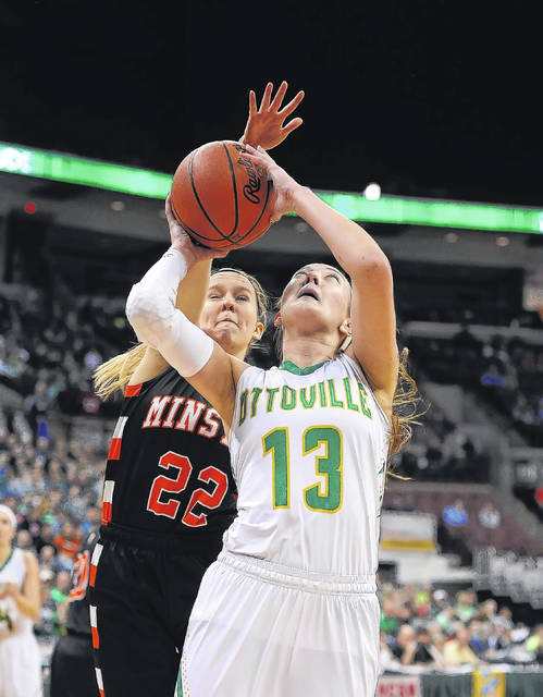 Ottoville's Bridget Landin shoots puts up a shot against Minster's Jessica Falk during Saturday's Division IV state final in the Value City Arena at the Schottenstein Center in Columbus.