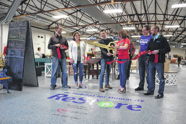 The Lima Area Chamber of Commerce held a ribbong cutting Saturday to commemorate the Lima Habitat for Humanity ReStore's new floor.