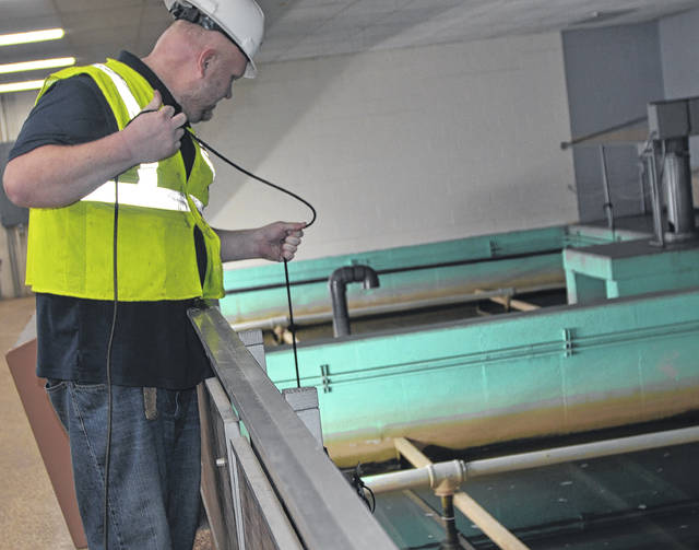 Semi-Automated Machine Intelligence CEO Jesse James Bohrer drops the Deep Trekker aquatic drone inside the Ottawa Waterworks Treatment Plant.