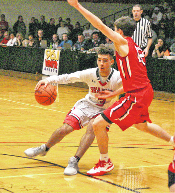 Shawnee's Riley Rosado tries to drive past Wauseon's Trent Armstrong during Saturday night's Division II district final at Ohio Northern University in Ada.