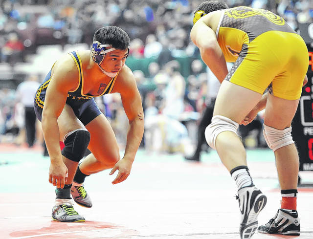Ottawa-Glandorf's Daniel Beemer, left, wrestles Apple Creek Waynedale's Logan Stanley in a Division III semifinal match at the state tournament at the Schottenstein Center in Columbus. See more state tournament photos in LimaScores.com.  Richard Parrish | The Lima News