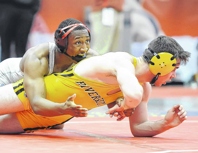 Lima Senior's Naeem Russell, left, wrestles Painesville Riverside's Alex Farenchak in a Division I match at the state tournament at the Schottenstein Center in Columbus.