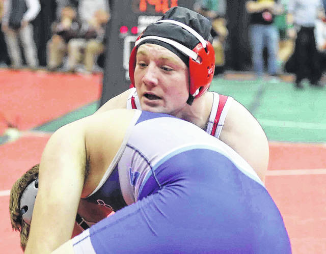 Wapakoneta's Evan Kaeck, top, competes against Louisville's Blake Robbins during a Division II match at the state tournament Thursday at The Ohio State University.