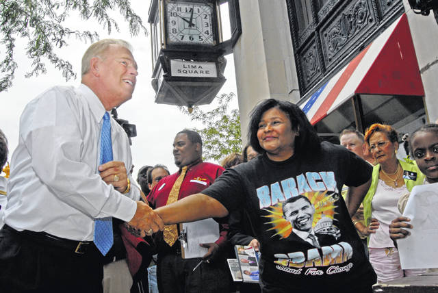 Antelle Haithcock, of Lima, greets Gov. Ted Strickland before he stood on a table to speak to Barack Obama supporters in downtown Lima at the opening of the Barack Obama Headquarters in 2008.