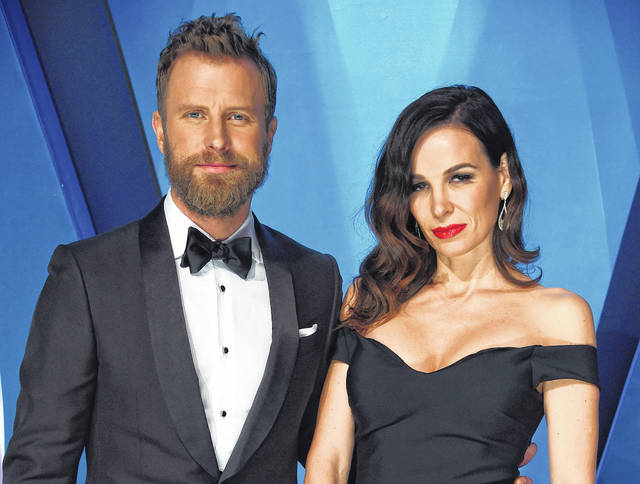 "Dierks Bentley, left, and his wife Cassidy Black arrive at the 51st annual CMA Awards in Nashville, Tenn., in November. Bentley hopes his new single reminds people that he's not always singing about being drunk on a plane, or being a beach bum looking for a rebound. Bentley will perform his new song, ""Woman, Amen,"" at the Academy of Country Music Awards in Las Vegas on April 15."