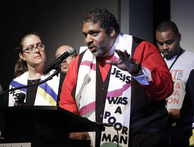 "The Rev. Dr. William J. Barber II, center, and Rev. Dr. Liz Theoharis, left, co-chairs of the Poor People's Campaign, speak at the National Civil Rights Museum Tuesday, April 3, 2018, in Memphis, Tenn. They announced the campaign is preparing for 40 days of non-violent ""direct action"" in about 30 states that will climax with a rally in Washington this June. The organization is the rekindling of the campaign to help poor people that the Rev. Martin Luther King Jr. was working on when he was killed April 4, 1968, in Memphis. (AP Photo/Mark Humphrey)"