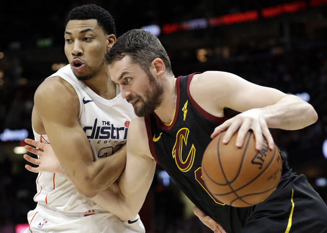 Cleveland Cavaliers' Kevin Love, right, drives past Washington Wizards' Otto Porter Jr. in the first half of an NBA basketball game, Thursday, April 5, 2018, in Cleveland. (AP Photo/Tony Dejak)
